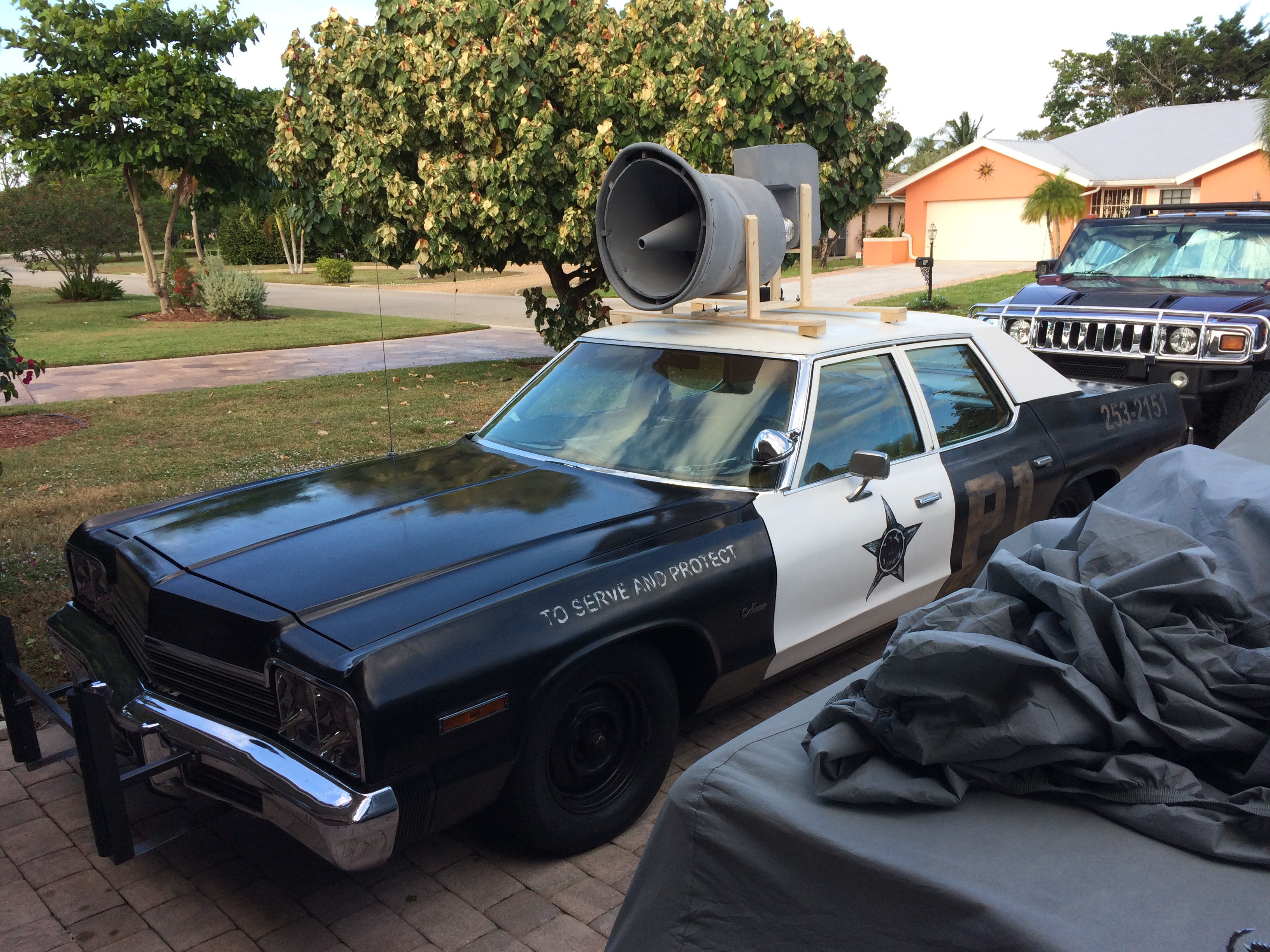 Joe's authentic 1974 Dodge Monaco Blues Brothers movie car with roof speaker.