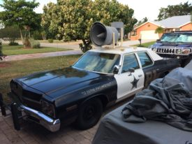 Joes authentic 1974 Dodge Monaco Blues Brothers movie car with roof speaker.