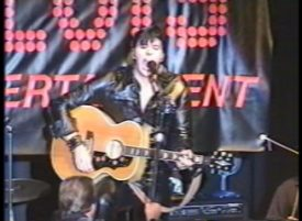 Joe Marino playing guitar as Elvis Presley 1968 Comeback Special in the famous black leather