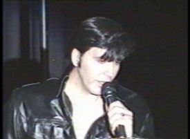 Joe Marino as 1968 Comeback Special Elvis Presley in black leather