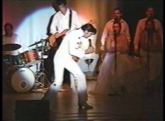 Joe Marino as Elvis Presley 1970 with band and backup vocalists The Sweet Harmonies