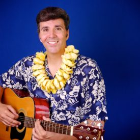 Joe Marino as Elvis Presley in Blue Hawaii